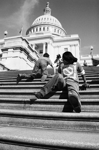 Members of ADAPT crawl up the steps to the U.S. Capitol.